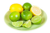 Lemon and lime fruits on a plate — Foto de Stock