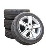 Four car tires on white background — Stock Photo