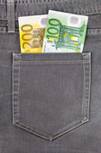Euro banknotes in jeans pocket — Stock Photo