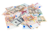 Heap of dollar and euro banknotes — Stock Photo