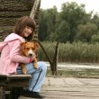 Girl holding a dog — Stock Photo