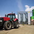Tractor in front of silos — Stock Photo #28480173