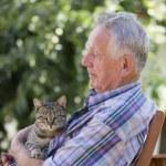Senior man with cat — Stock Photo #28758447