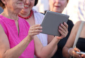 Older woman with tablet — Stock Photo