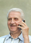 Pensioner with cell phone — Stock Photo