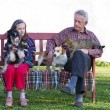 Stock Photo: Girl and her grandfather with pets
