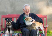 Old man with his pets — Stock Photo