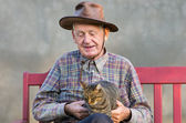 Old man with cat — Stock Photo