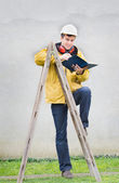 Engineer leaned on ladder — Stock Photo