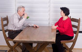 Okd couple at table — Stock Photo