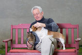 Senior man with pets — Stock Photo