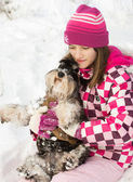 Girl with dog in lap — Stockfoto