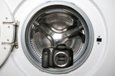 Camera in washing machine — Stock Photo