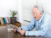 Old man yawning — Stock Photo