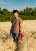 Attractive man in barley field — Stock Photo