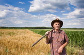 Man with fork in field — Stock Photo