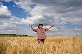 Happy man in wheat field — Stock Photo