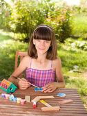 Girl doing craft — Stock Photo