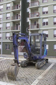 Blue mini excavator — Stock Photo