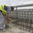 Stock Photo: Construction worker working on concrete wall