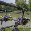 Stock Photo: Three Fishing Rods and Reels