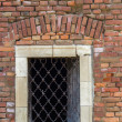 Old red brick wall  with bars window 2 — Stock Photo