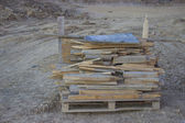 Wooden poles on a pallet — Stockfoto