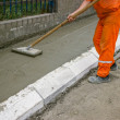 Stock Photo: Worker leveling fresh Concrete 4