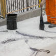 Stock Photo: Asphalt worker apply tack coat (Bitumen Emulsion) with broom 2