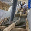 Manual workers pouring concrete steps — Stock Photo