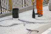 Asphalt worker apply tack coat (Bitumen Emulsion) with a broom 2 — Stock Photo