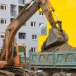Stock Photo: Excavator loading dumper truck 4