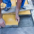 Stock Photo: Worker puts concrete pavers 3