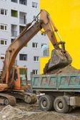 Excavator loading dumper truck 4 — Stock Photo