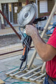 Building worker with Angle Grinder — Stock Photo