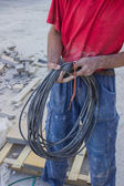 Building worker with electrical cable — Stock Photo