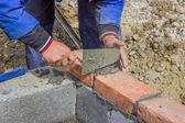 Man laying concrete block and bricks wall 2 — Stock Photo