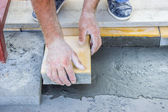 Worker puts concrete pavers 2 — Stock Photo