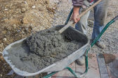 Worker with concrete mortar in wheelbarrow 4 — Stock Photo