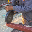 Close up of metal worker using angle grinder to grinding metalba — Stock Photo