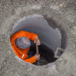 Stock Photo: Working in manhole, worker inside manhole 3