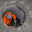 Stock Photo: Working in manhole, worker inside manhole 4