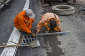 Workers on a road construction set out the string lines and leve — Stock Photo
