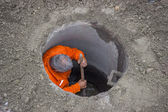 Working in a manhole, worker inside a manhole 3 — Stock Photo