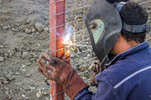 Welder working on installation a metal fence 2 — Stock Photo