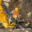 Stock Photo: Trenches and Excavations, worker sets protection shields to prot