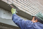 Trowel spreading mortar on concrete wall 3 — Stock Photo