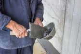 Trowel spreading mortar on concrete wall — Stock Photo