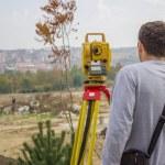Land surveyor behind theodolite 2 — Stock Photo