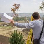 Land surveyor behind theodolite 3 — Stock Photo